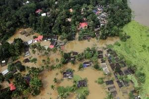An aerial view shows partially submerged houses at a flooded area in the southern state of Kerala, India.