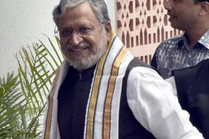 Deputy Chief Minister of Bihar Sushil Kumar Modi arrives for the BJP Chief Ministers