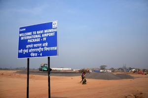 A notice indicating the site of the Navi Mumbai International Airport in Ulwe. (Bachchan Kumar/ HT Photo)