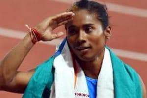Hima Das celebrates after securing silver medal in the women
