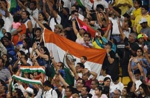 Indian fans celebrate after their team