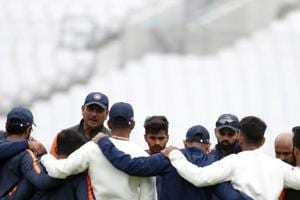 The Indian cricket coach Ravi Shastri, second left speaks to the team ahead of the 5th cricket test match between England and India at the Oval cricket ground in London, Wednesday, Sept. 5, 2018. England and India are playing a 5 test series, with the 5th and final test starting Friday. (AP Photo/Alastair Grant)