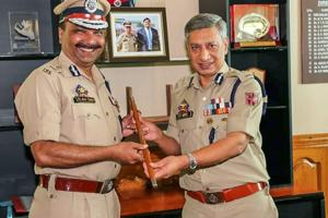 Former DGP SP Vaid passes on the baton to Dilbag Singh.