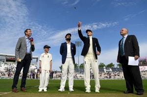 England captain Joe Root tosses the coin alongside India captain Virat Kohli ahead of the Specsavers 4th Test match between England and India at The Ageas Bowl on August 30, 2018 in Southampton, England.