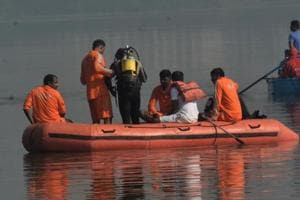 NDRF on search and rescue operation of people who went missing after a boat capsized in a lake in Mumbai in December 2016. A child is missing while 20 passengers swam ashore after a boat capsized on Thursday in the Bhairav River near West Bengal's Garibpur, an official said.