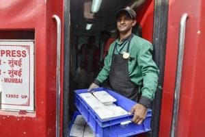 An Indian Railway Catering and Tourism Corporation (IRCTC ) worker carries food to serve the passengers on Rajdhani Express trains.