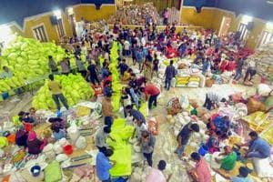 Volunteers segregating flood relief material at a distribution centre for Kerala floods, in Kochi on Sunday, September 2, 2018.