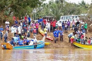 Volunteers and locals ride a boat to as they head out to clean Panamaram River, in Wayanad on Thursday, Aug 30, 2018.