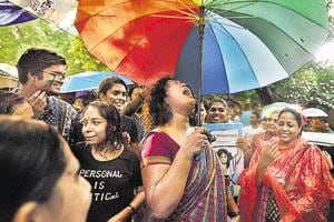 Members and well-wishers of the LGBTQ community celebrate the Supreme Court verdict. (Raj K Raj/ HT Photo)