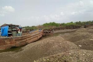 Sand excavation and mangrove destruction at a creek in Navi Mumbai.