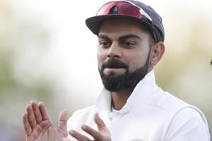 Virat Kohli applauds his players off the pitch at the end of during Day 1 of the fifth Test between India and England.