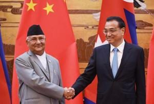 Nepal Prime Minister KP Sharma Oli (left) shakes hands with Chinese Premier Li Keqiang during a signing ceremony at the Great Hall of the People in Beijing.