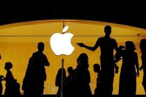 Customers walk past an Apple logo inside of an Apple store at Grand Central Station in New York, US.