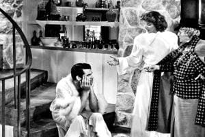 Cary Grant and Katharine Hepburn  in the 1938 film Bringing Up Baby, where Grant used the word 'gay' on screen. Opinion is divided though, on whether he used it to mean homosexual or happy and cheerful.