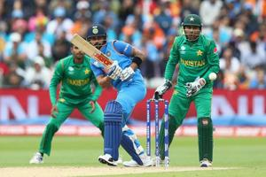 BIRMINGHAM, ENGLAND - JUNE 04: Virat Kohli of India plays to the offside as Pakistan wicketkeeper Sarfraz Ahmed looks on during the ICC Champions Trophy match between India and Pakistan at Edgbaston on June 4, 2017 in Birmingham, England.