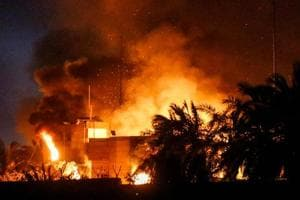 The burning headquarters of the Iranian consulate in the southern Iraqi city of Basra which was torched by protesters during demonstrations over poor public services, after parliament called for an emergency session on the unrest.