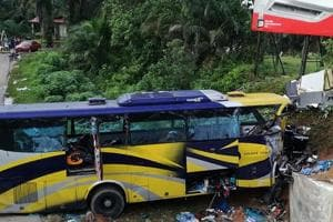 At least 13 people were killed when a passenger bus collided with a truck parked on a road in southern Afghanistan on Saturday and overturned, officials said.