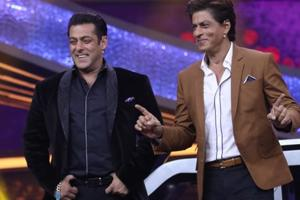 Actor and host of the reality television show Dus Ka Dum, Salman Khan with actor Shah Rukh Khan on the sets of the show, in Mumbai.