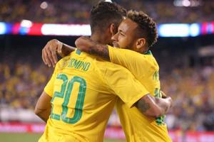 Sep 7, 2018; East Rutherford, NJ, USA; Brazil forward Roberto Firmino (20) celebrates his goal against the United States with Brazil forward Neymar (10) during the first half of an international friendly soccer match at MetLife Stadium.
