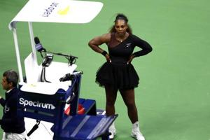 NEW YORK, NY - SEPTEMBER 08: Serena Williams of the United States reacts after her defeat in the Women