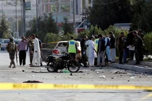 Afghan security forces inspect the site of a suicide attack in Kabul, Afghanistan.