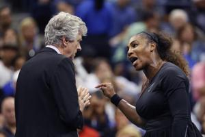 Serena Williams talks with referee Brian Earley during the women