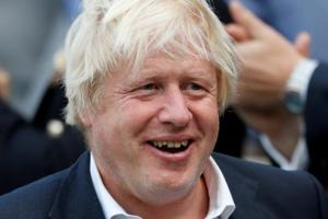 """In an article in the Mail on Sunday newspaper, Johnson pressed his attack on May's so-called Chequers plan to leave the EU, calling it """"a humiliation"""" that opens """"ourselves to perpetual political blackmail""""."""