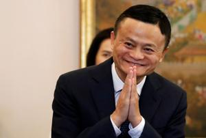 Alibaba founder Jack Ma gestures as he arrives for a meeting in Bangkok.