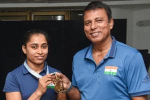 New Delhi: Gymnast Dipa Karmakarwith her coach Bisweshwar Nandi poses for photographs with her gold medal, won at Turkey, during a media interaction at Indira Gandhi Stadium, in New Delhi on Tuesday, July 10, 2018.