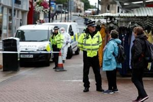 Police officers secure an area of the town centre after reports of a stabbing in Barnsley, Britain.
