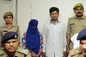 The two accused in police custody at the SSP office, Sector 14A, in Noida, on Sunday.
