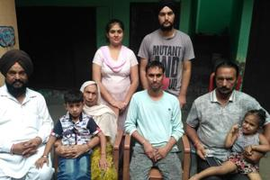 Kamal Manjinder Singh (centre) with his family in Gurdaspur on Sunday.