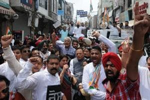 State Congress president Sunil Jakhar along with MP Santokh Chaudhary raising slogans against Prime Minsiter Narendra Modi over steep hike in petrol and diesel prices during a protest rally in Jalandhar on Monday.