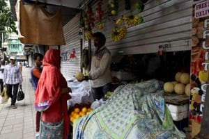 Shops were partially opened during the Bharat bandh protest at Byculla east in Mumbai, on Monday.