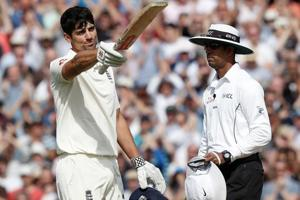 Alastair Cook (L) celebrates his century during play on the fourth day of the fifth Test cricket match against India.