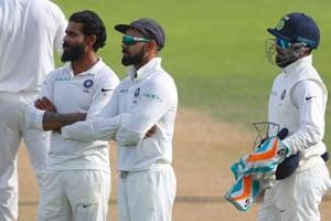 Ravindra Jadeja and Virat Kohli wait for the decision of the third umpire after reviewing a decision during day three of the 5th Test at the Oval on Sunday.