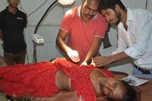 Sabita Devi was injured after being hit by a bullet while sitting outside her house in Dhanbad on Saturday night.
