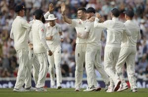 James Anderson, center, celebrates taking the wicket of India