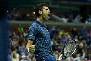Novak Djokovic celebrates a point while playing Juan Martin del Potro of Argentina during their 2018 US Open men