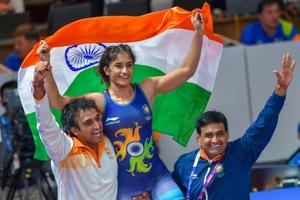 Vinesh Phogat celebrates after winning the gold medal in women