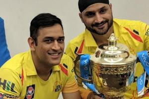 MSDhoni and Harbhajan Singh pose with the Indian Premier League (IPL)2018 trophy.