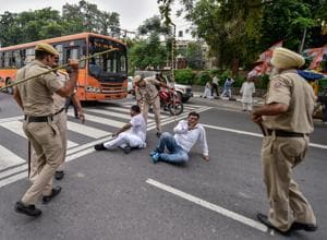 Policemen lathi charge Congress workers taking part in the Bharat Bandh protests in New Delhi on Monday.