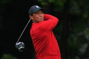 Tiger Woods plays his tee shot on the fourth hole during the weather delayed final round of the BMW Championship at the Aronimink Golf Club.