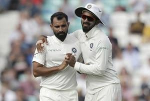 Mohammed Shami (left) celebrates after dismissing  Jonny Bairstow at the Oval on Monday.