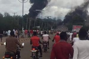 A smoke and fire are seen during a gas explosion in Lafia, Nigeria, September 10, 2018, in this image obtained from social media.