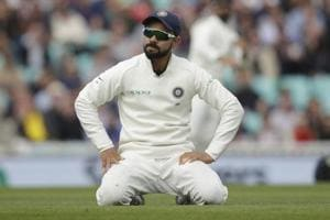 Virat Kohli kneels after fielding during the fifth cricket test match between India and England at the Oval.
