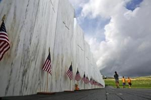 In this May 31, 2018 file photo, visitors to the Flight 93 National Memorial pause at the Wall of Names honouring 40 passengers and crew members of United Flight 93 killed when the hijacked jet crashed at the site during the 9/11 terrorist attacks, near Shanksville, Pennsylvania.