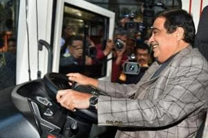 Union minister Nitin Gadkari sits on the driving seat of an electric vehicle. The transition towards electric mobility requires not just private sector participation but also massive public buy-in