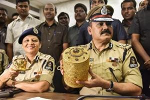 Police Commissioner Anjani Kumar along with a senior police officer shows to media the three-tier golden tiffin box and a golden cup after their recovery, in Hyderabad, Tuesday, Sep 11, 2018.
