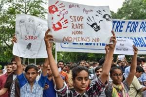 Activists display placards to demand the speedy justice for a rape victim during a protest at Jantar Mantar in New Delhi on Monday, July 30, 2018.